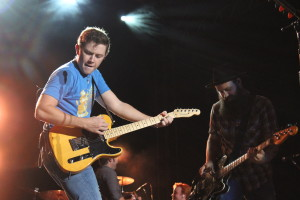 Scotty McCreery, left, plays with bassist Nathan Thomas Thursday night.