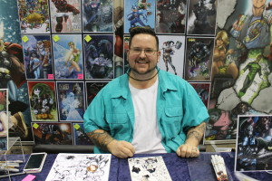 (Photo by Andy Lyons) Illustrator Jeff Balke at his booth during Planet Comicon 2015.