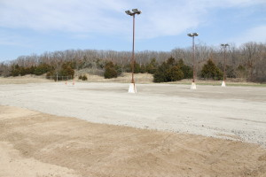 (Photo by Andy Lyons) The sand volleyball courts at Cave Hollow have been smoothed out in preparation for the dog park.