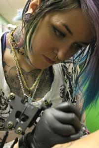 (Photo by Andy Lyons) Terra Walker works on a tattoo at the Dublin Social Club, located at 126 N. Holden St. Warrensburg, Mo.