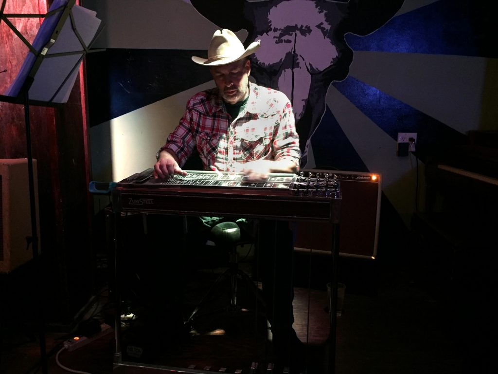 (Photo by Paul Joyner) Colm Comickey plays the lap steel guitar.