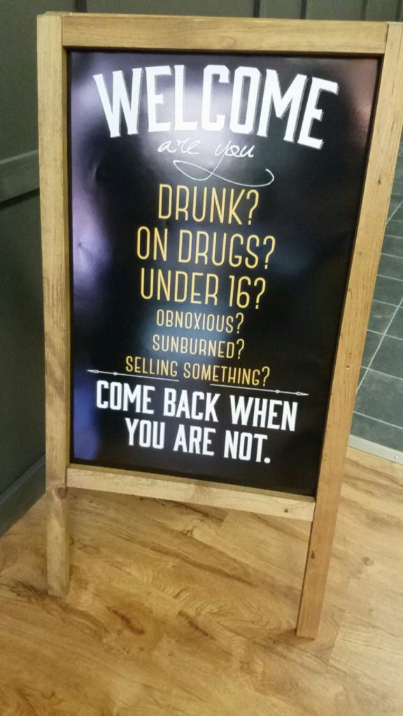 (Photo by Andy Lyons) This sign sits in front of the door at Black Compass Tattoo Company.